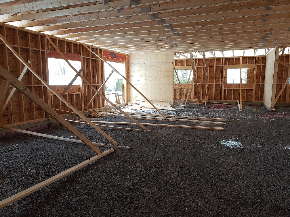 inside the building, shows the rafters in place and walls