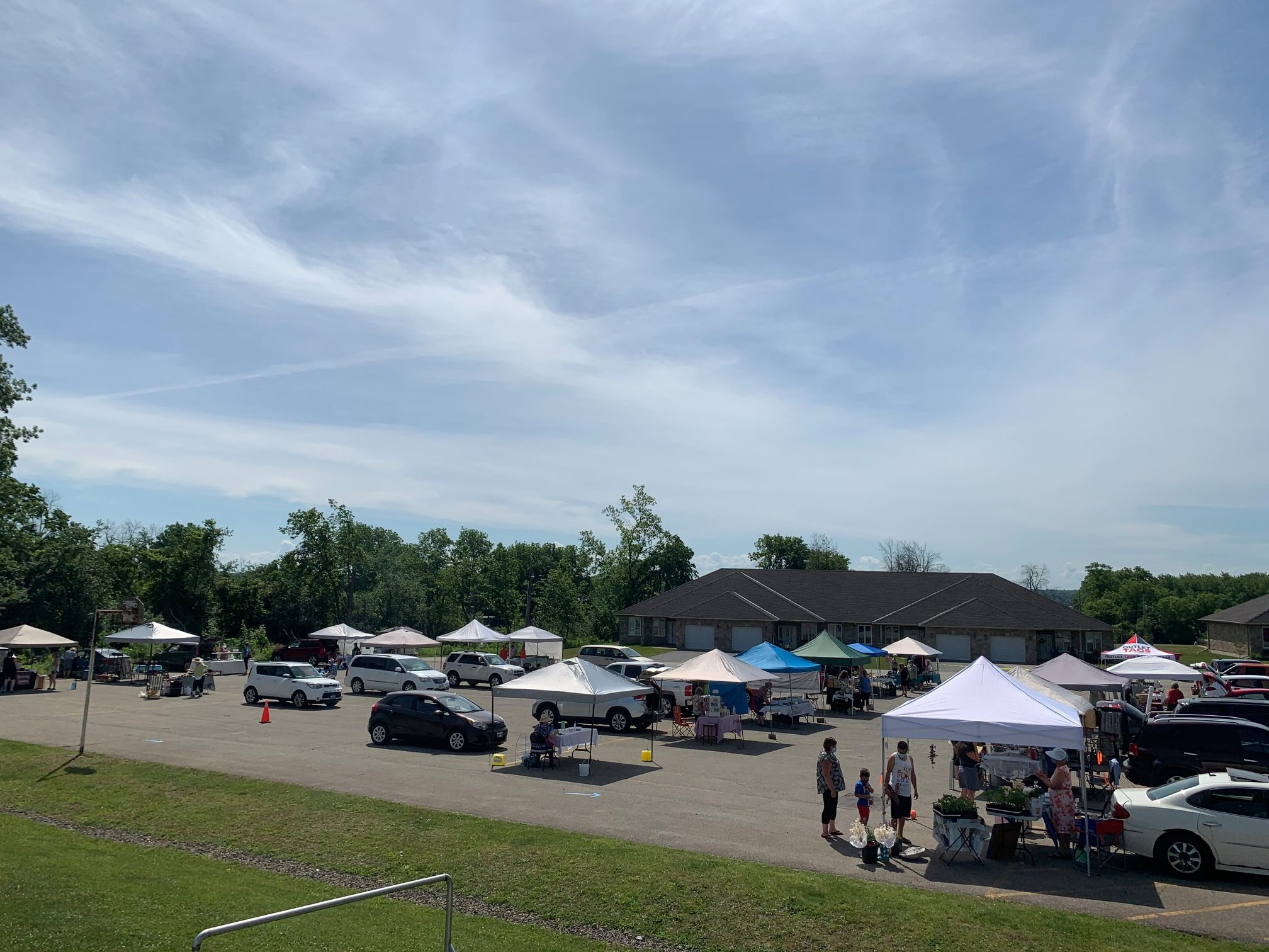 tents set up at the farmer's & craft market June 12, 2021