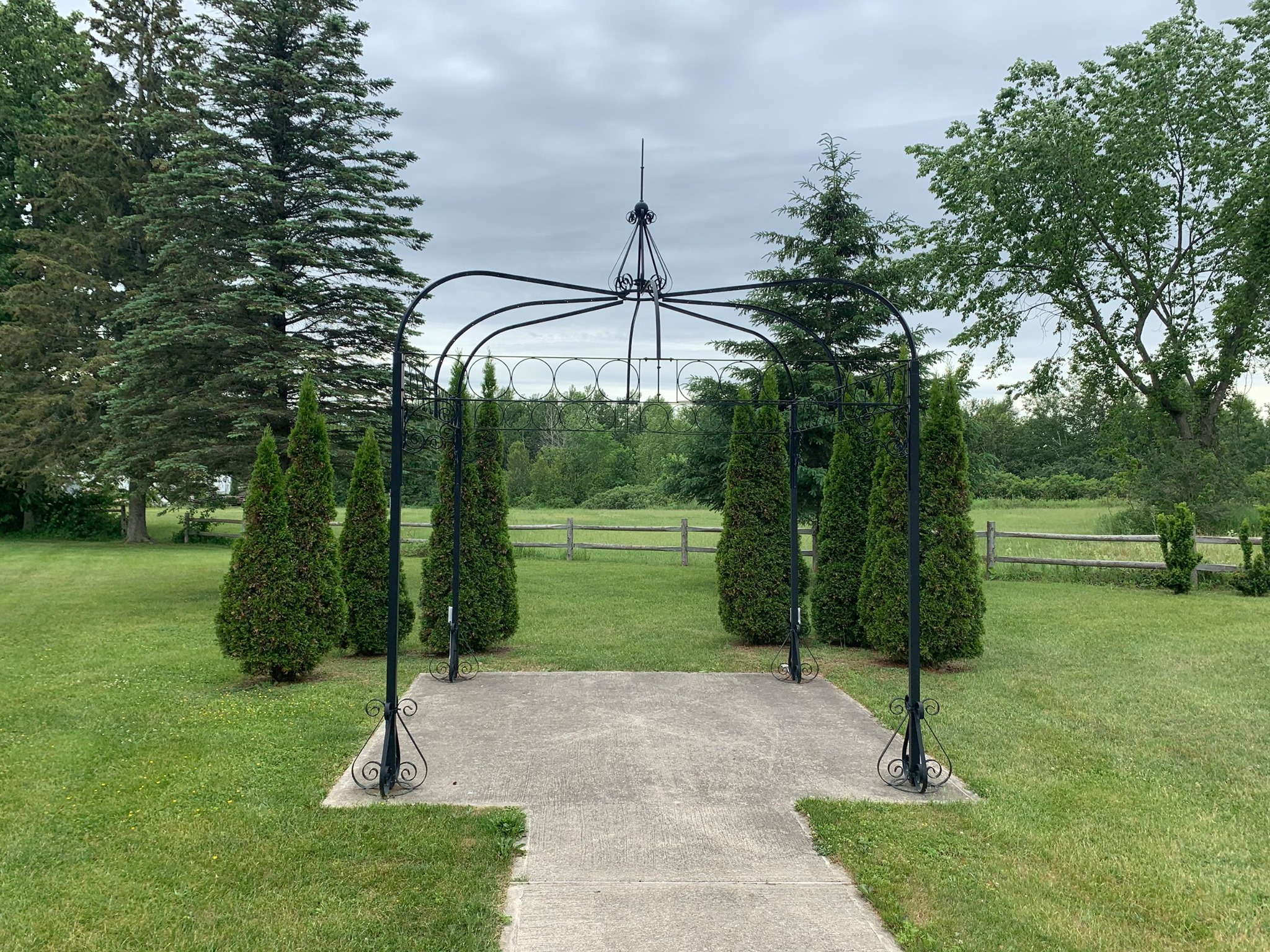 archway and topiary-type trees at the roebuck recreation centre