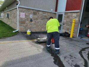 public works employee using fire extinguisher