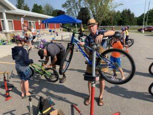 gentlemen repairing bicycles