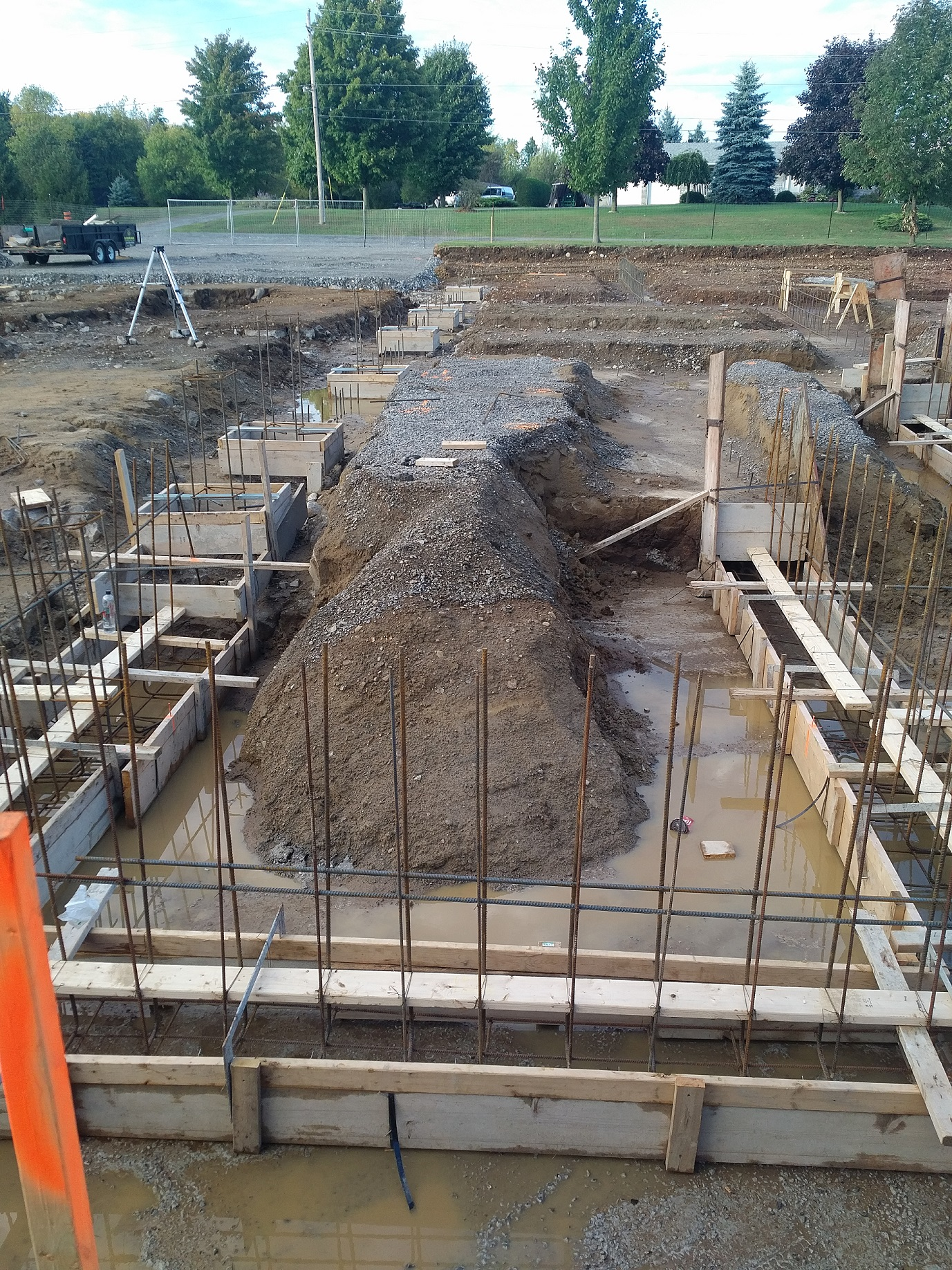 forms and rebar in place for foundation footings and walls