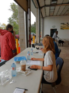 a lady registering her pet at the rabies clinic