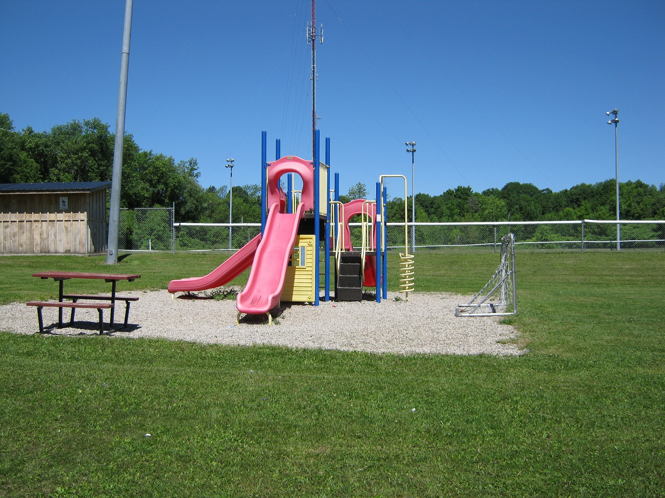 Children's play structure with picnic table