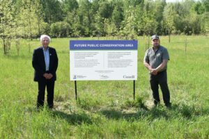 Mayor Malanka and SNC Representative with sign announcing future site of Mill Run Conservation Site
