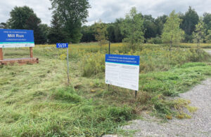 Mayor Malanka and SNC RepresentatiSigns at Mill Run Conservation Site